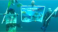 Aksi penyelam Gorontalo memberikan dukungan kepada Palestina melalui bawah Laut (Arfandi Ibrahim/Liputan6.com)