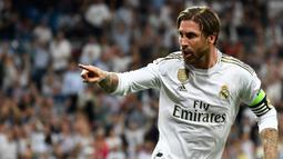 Sergio Ramos (71 gol) - Sergio Ramos menjadi bek yang sangat produktif di kompetisi La Liga musim ini. Kapten Real Madrid ini telah menorehkan 69 gol untuk El Real dan 2 gol saat besama Sevilla. (AFP/Pierre-Philippe Marcou)