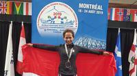 Srikandi wanita yang panggilan akrabnya, Sari, wanita kelahiran Pakpak, Dairi, Sumatera Utara,17 Juni 1971, berhasil menjuarai kejuaraan World Masters Weightlifting Championship 2019 di Montreal, Kanada untuk kategori kelas umur 45-49 tahun (Istimewa)