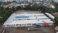 Pertamina kembali menyiapkan lapangan sepak bola Simprug seluas 22.700 meter persegi untuk menjadi rumah sakit rujukan tambahan. Dok Pertamina