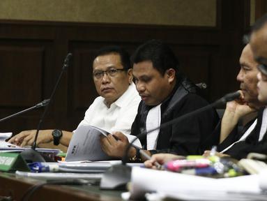 Terdakwa korupsi pengadaan dan pelaksanaan pembangunan kampus IPDN Sumbar di Kab Agam TA 2011, Dudy Jocom menjalani sidang lanjutan di Pengadilan Tipikor Jakarta, Rabu (10/10). Sidang mendengar keterangan saksi dari JPU. (Liputan6.com/Herman Zakharia)
