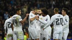 Juara grup A, Real Madrid. Klub asal Spanyol ini siap menambah gelar Liga Champions mereka yang ke-11. (AFP/Pierre-Philippe Marcou)