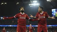 Mohamed Salah dan Roberto Firmino bermain gemilang saat Liverpool menyingkirkan Manchester City. (AP Photo/Rui Vieira)