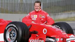 Setelah bergabung bersama Ferrari pada 1996, Schumacher menjadi juara F1 selama lima musim beruntun sehingga menempatkannya sebagai pebalap F1 dengan gelar juara dunia terbanyak. (AFP/Patrick Hertzog)