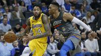 Russell Westbrook (nomor 0) Berusaha mengadang pemain Lakers Brandon Ingram (AP)