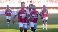 Selebrasi gol Persipura yang dicetak Muhammad Tahir ke gawang PSS di Stadion Maguwoharjo, Sleman (19/9/2019). (Bola.com/Vincentius Atmaja)