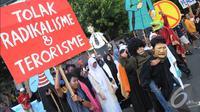 Aksi 'Jaga Jakarta' yang didominasi oleh kaum muda ini mengajak   warga Jakarta untuk bersama-sama menolak radikalisme dan terorisme,   Jakarta, Minggu (23/11/2014). (Liputan6.com/Herman Zakharia)