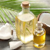 Cara Mencerahkan Wajah Kusam dengan minyak kelapa (sumber: istockphoto)