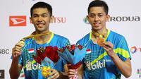 Fajar Alfian/Muhammad Rian Ardianto berhasil merengkuh gelar Malaysia Masters 2018 setelah mengalahkan Goh V Shem/Tan Wee Kiong, Minggu (21/1/2018). (PBSI)