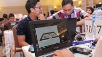 Peserta kompetisi mandiri Hackaton 2016 saat berlomba membuat aplikasi di Jakarta, (26/2). Ajang adu kreativitas developer IT ini digelar Bank Mandiri untuk mengembangkan bibit digital technopreneur potensial di Tanah Air.  (Liputan6.com/Angga Yuniar)