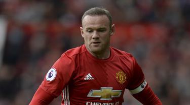 10. Wayne Rooney - Sempat menjadi pemain bergaji termahal di Manchester United. Lantas Rooney membeli Dassault Falcon 900LX dengan harga fantastis, 20 Juta Dolar. (AFP/Oli Scarff)
