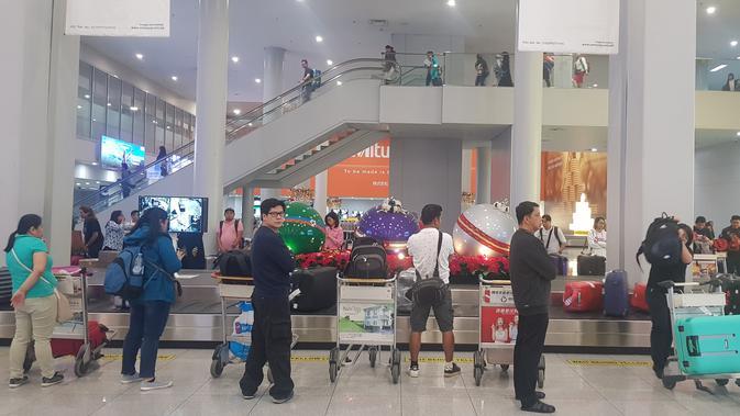 Situasi di bandara Ninoy Aquino tidak identik dengan atribut SEA Games 2019. (Bola.com/Zulfirdaus Harahap)