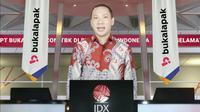 Tangkapan layar menampilkan Direktur Utama PT. Bukalapak.com Tbk, M Rachmat Kaimuddin saat membèri sambutan pencatatan perdana saham BUKA secara virtual, Jakarta, Jumat (6/8/2021). (Liputan6.com)