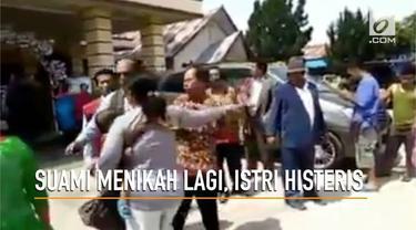 Rekaman video seorang istri mendatangi tempat pernikahan suami yang menikah lagi.
