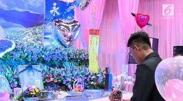 Seorang Pria di Taiwan memutuskan untuk bertunangan dengan kekasihnya yang sudah meninggal.
