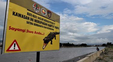 papan informasi keberadaan buaya muara di sungai palu