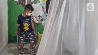 FOTO: Antusias Anak Sekolah Ikut Imunisasi DT