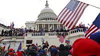 Banner Infografis Rusuh di Capitol Hill AS. (AP Photo/Shafkat Anowar)