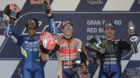 Marc Marquez (tengah) memenangkan MotoGP Jerez 2019, Minggu (5/5/2019). Dia diapit Alex Rins dan Maverick Vinales. (AFP/Jorge Guerrero)