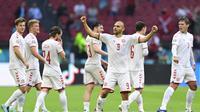 Striker Denmark Martin Braithwaite merayakan gol pertamanya di Euro 2020 / 2021 (AFP)
