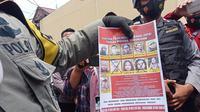 DPO kelompk MIT yang masih dikejar aparat Satgas Madago Raya. Usai tewasnya dua anggota kelompok tersebut dalam baku tembak dengan aparat, tersisa 9 orang lagi yang masih dicari. (Foto: Heri Susanto/ Liputan6.com).