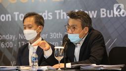 "Chief Strategic Officer Jikyu Jang (kanan) saat keterangan pers virtual ""Transformasi Menuju Bukopin Baru"" di Jakarta, Senin (30/11/2020). Kehadiran KB Kookmin Bank telah memberikan dampak positif terhadap permodalan, perbaikan proses internal, dan pengawasan. (Liputan6.com/Fery Pradolo)"