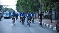 Ahmad Sahroni mendirikan komunitas sepeda  bernama ASC Goweser. (Liputan6.com/Putu Merta Surya Putra)