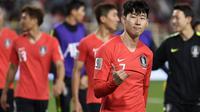 Pemain Timnas Korea Selatan, Son Heung-min, seusai laga melawan China di Piala Asia 2019 (16/1/2019). (AFP/Khaled Desouki)