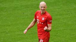 1. Arjen Robben - Mantan bintang Bayern Munchen ini memutuskan gantung sepatu pada akhir musim 2018-2019. Namun, sang pemain baru-baru ini memutuskan untuk kembali ke lapangan hijau untuk memperkuat klub profesional pertamanya, FC Groningen. (AFP/Christof Stache)