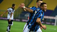 Alexis Sanchez usai mencetak gol ke gawang Parma pada laga lanjutan Liga Italia 2020/2021, Jumat (05/03/2021) dini hari WIB. (MIGUEL MEDINA / AFP)