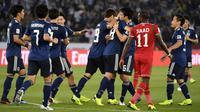 Timnas Jepang meraih kemenangan 1-0 atas Oman pada laga kedua Grup F Piala Asia 2019, di Sheikh Zayed Sports City, Abu Dhabi, Minggu (13/1/2019). (AFP/Khaled Desouki)