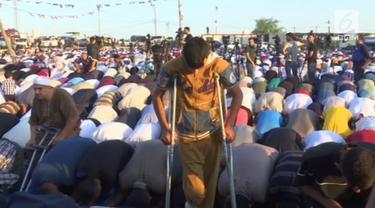 Di tengah suasana konflik di Jalur Gaza, umat muslim tetap merayakan Hari Raya Idul Fitri.