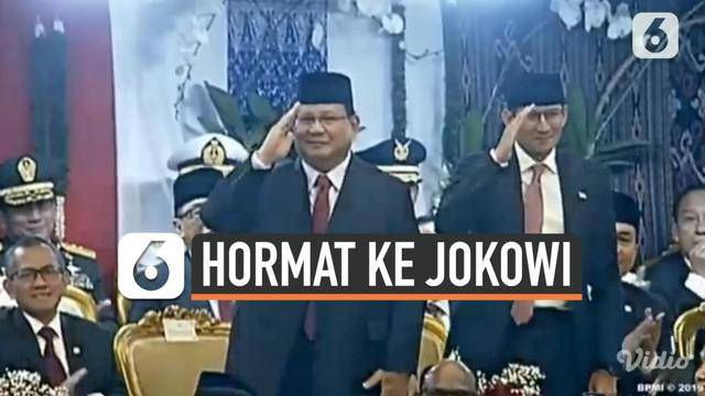 Mendengar namanya disebut, Prabowo Subianto dan Sandiaga Uno kompak berdiri dan memberi hormat kepada Jokowi. Saat itu, Jokowi tengah membuka pidato perdananya dan  menyampaikan salam hormat kepada keduanya.