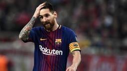 1. Lionel Messi (Barcelona) - 12 Gol (1 Penalti). (AFP/Aris Messinis)