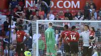 Pemain Manchester United (MU) usai menghadapi Cardiff City pada laga terakhir Liga Inggris di Old Trafford, Minggu (12/5/2019). (AP Photo / Rui Vieira)