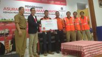 Ribuan Pegawai Harian Lepas Dinas Kebersihan DKI Jakarta menerima asuransi gratis (Liputan6.com/Ditto)
