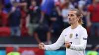 Antoine Griezmann beraksi dalam duel Prancis Vs Hungaria di pada matchday kedua Grup F Euro 2020 di Ferenc Puskas Stadium, Budapest, Sabtu (19/6/2021). (AFP/Bernadett Szabo)