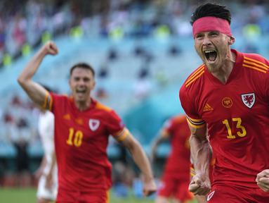 Gelandang Wales, Kieffer Moore menjadi penentu hasil imbang 1-1 lewat gol sundulannya ke gawang Swiss pada menit ke-73 memanfaatkan umpan lambung Joe Morrel. (Foto: AP/Darko Vojinovic/Pool)