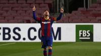 Lionel Messi dengan gaya khasnya usai cetak gol Barcelona ke gawang Athletic Bilbao di Liga Spanyol (AP)