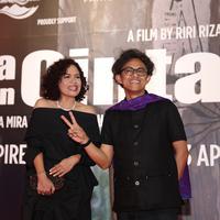 Mira Lesmana dan Riri Riza saat premier AADC 2. (Andy Masela/Bintang.com)