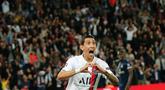 Pemain sayap Paris Saint-Germain (PSG), Angel Di Maria melakukan selebrasi usai mencetak gol ke gawang Real Madrid pada laga Grup A Liga Champions di Parc des Princes, Rabu (18/9/2019). PSG berhasil menaklukkan tamunya Real Madrid 3-0. (AP Photo/Francois Mori)