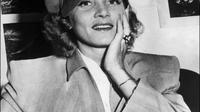 Ilustrasi perempuan memakai topi dilengkapi pin. (AFP)