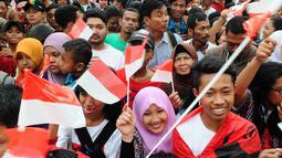 Acara perayaan ini digelar oleh gabungan tim relawan Jokowi-Jusuf Kalla di Tugu Proklamasi, Jakarta Pusat, Rabu (23/7/14). (Liputan6.com/Andrian M Tunay)