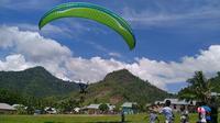 Menikmati Wisata Ekstrim Paralayang di Bukit Lelato, Kabupaten Pahuwato. (Arfandi Ibrahim/Liputan6.com