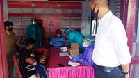 Polres Minahasa memfasilitasi pelaksanaan rapid test untuk mahasiswa asal Papua bersama keluarga yang tertahan di Kabupaten Minahasa, Sulut.