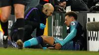Dele Alli dipastikan absen membela Tottenham Hotspur hingga awal Maret 2019, karena dibekap cedera hamstring. (AFP/Adrian Dennis)