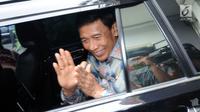 Menko Polhukam Wiranto usai melakukan pertemuan dengan Ketua KPU, Arief Budiman di Gedung KPU, Jakarta, Selasa (6/3). Pertemuan berlangsung sekitar satu jam dan tertutup. (Liputan6.com/Helmi Fithriansyah)