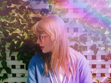 Meski belum resmi mengumumkan judul album terbarunya, Taylor sudah mulai memberi clue mengenai albumnya. Taylor kerap mengunggah foto dirinya dengan tema penuh warna seperti pelangi dan warna-warna pastel. (Liputan6.com/IG/@taylorswift)