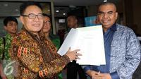Wakil Ketua Umum PPP hasil Muktamar Bandung Emron Pangkapi (kiri) bersama Anggota DPR Fraksi PPP Irgan Chairul Mahfiz  (Liputan6.com/Helmi Afandi)