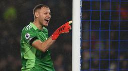Aaron Ramsdale telah menorehkan tiga clean sheet dan satu kebobolan dalam empat laga di Liga Inggris. Ia didatangkan menuju Arsenal dari Sheffield United yang telah terdegradasi pada musim lalu. (AFP/Glyn Kirk)
